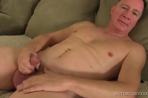 Carlos strokes and twists his massive cock for Victor Gay XXX Gay Porn Tube Video Image