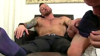 Tattooed stud gets his socks stripped for gay foot worship on chair